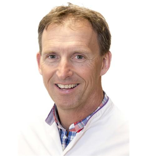 Dr. Arnold Besselaar